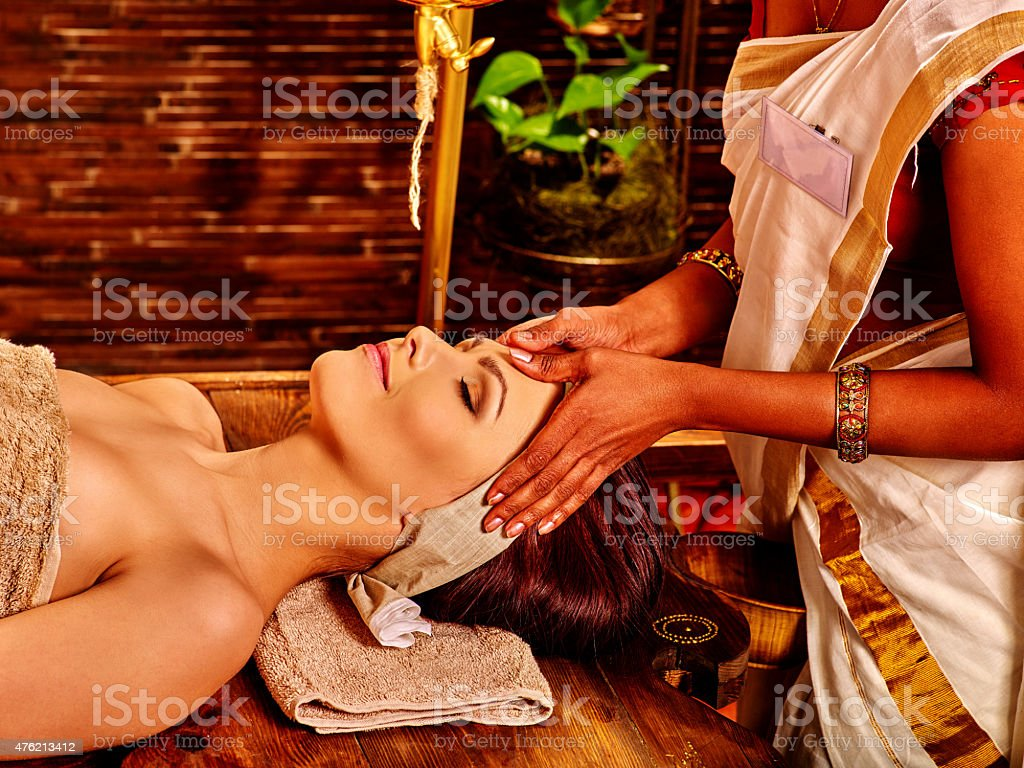 Woman having ayurveda spa treatment stock photo
