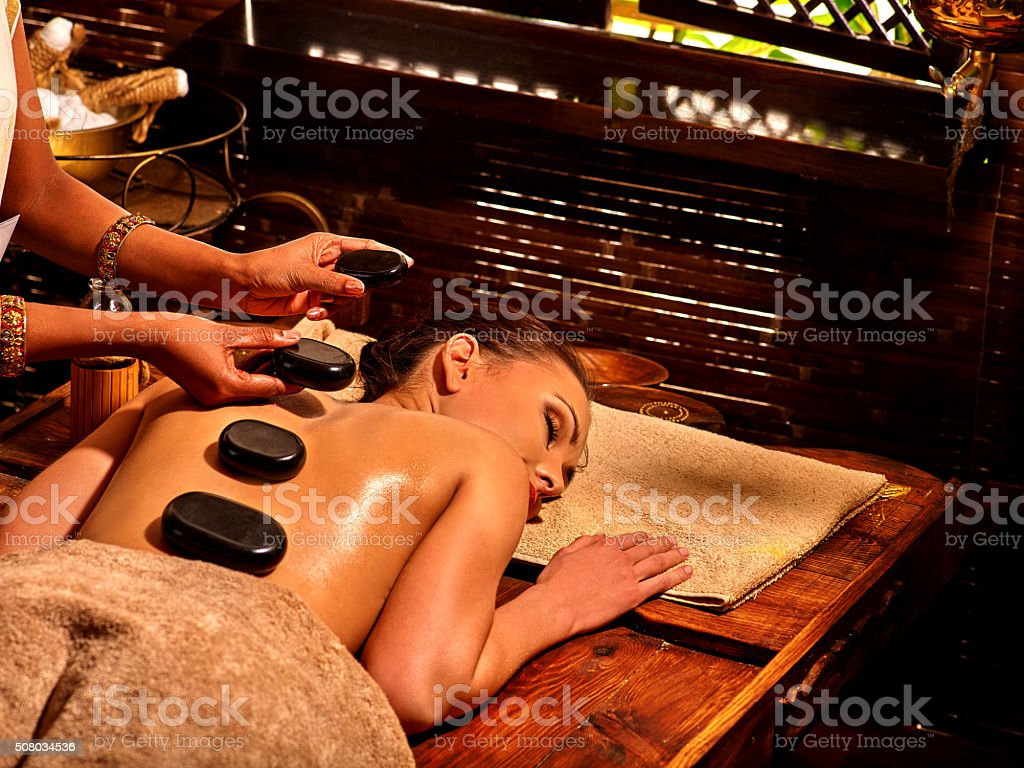 Woman having Ayurvedic stone massage stock photo