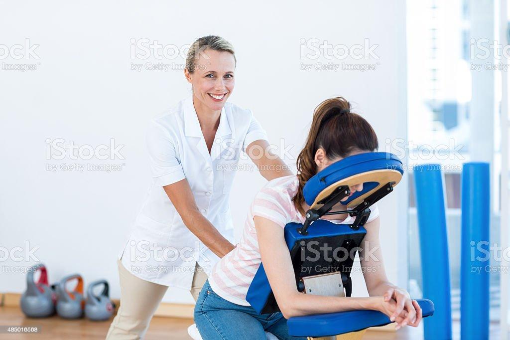Woman having back massage stock photo
