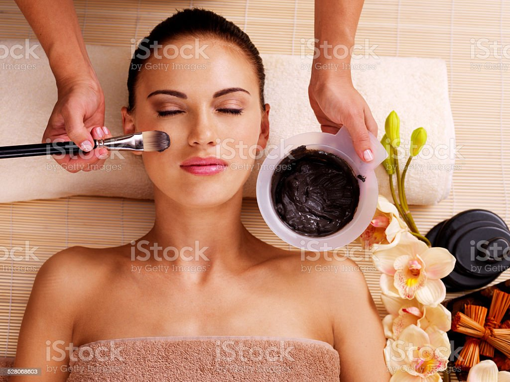 woman having beauty treatments  in the spa salon stock photo