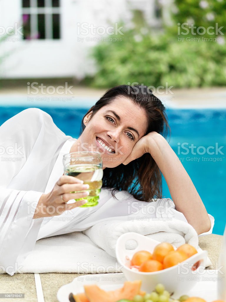Woman having breakfast by the pool royalty-free stock photo