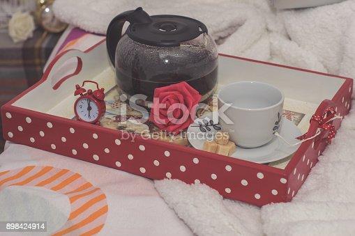 618750646istockphoto Woman having breakfast in bed 898424914
