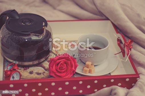 618750646 istock photo Woman having breakfast in bed 898425020