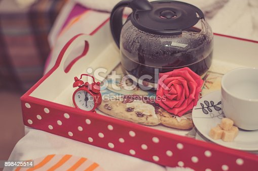 618750646 istock photo Woman having breakfast in bed 898425514