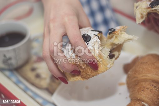 618750646istockphoto Woman having breakfast in bed 898425806