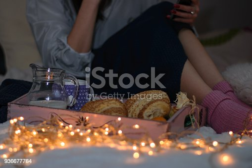 618750646istockphoto Woman having breakfast in bed 936677764