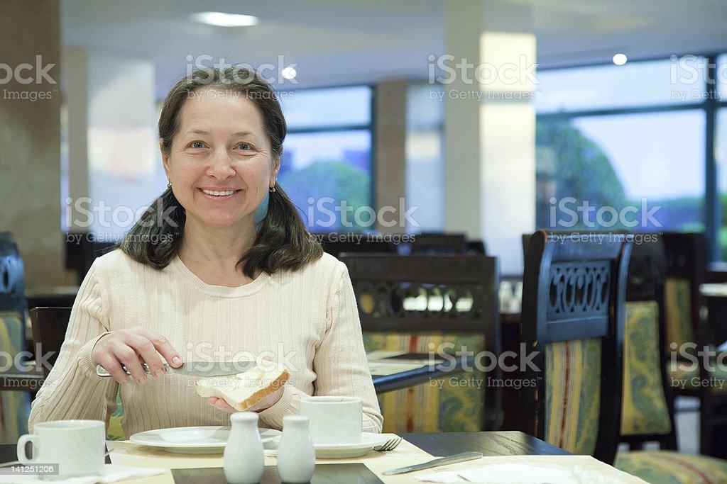 Woman having breakfast royalty-free stock photo