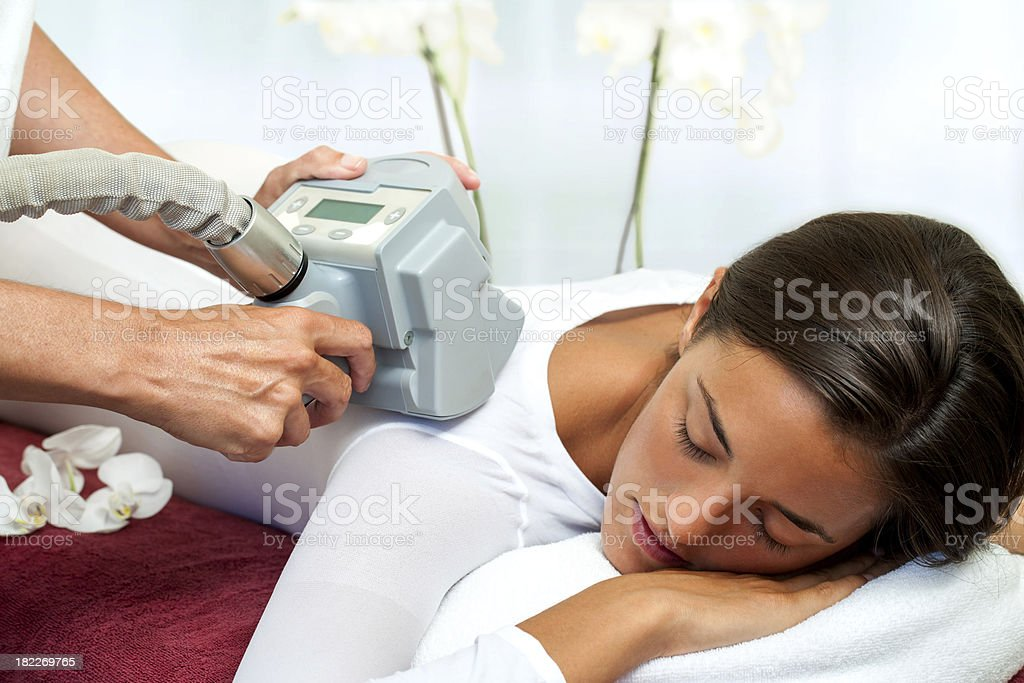 Woman having cellulite reduction massage. stock photo