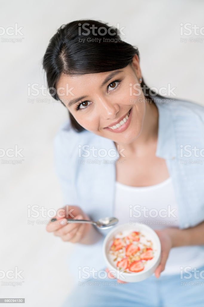Woman having cereal for breakfast royaltyfri bildbanksbilder