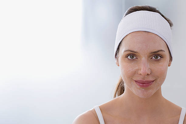 woman having chemical peel - chemical peel stock pictures, royalty-free photos & images