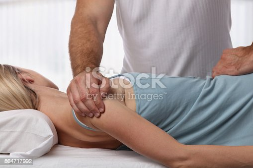 863158416istockphoto Woman having chiropractic back adjustment. Osteopathy, Alternative medicine, pain relief concept. Physiotherapy, sport injury rehabilitation 864717992
