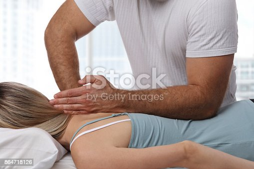 863158416istockphoto Woman having chiropractic back adjustment. Osteopathy, Alternative medicine, pain relief concept. Physiotherapy, sport injury rehabilitation 864718126