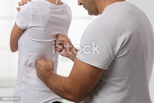 863158416istockphoto Woman having chiropractic back adjustment. Osteopathy, Physiotherapy, sport injury rehabilitation concept 866226412