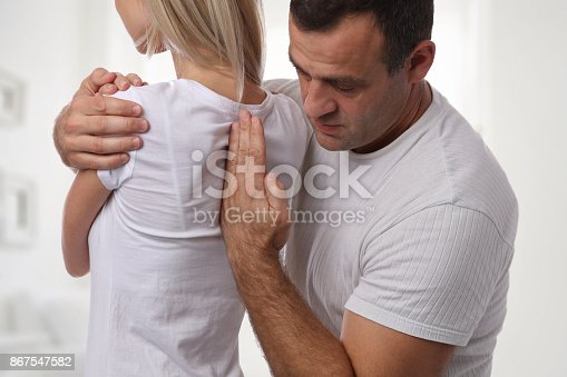 863158416istockphoto Woman having chiropractic back adjustment. Osteopathy, Physiotherapy, sport injury rehabilitation concept 867547582