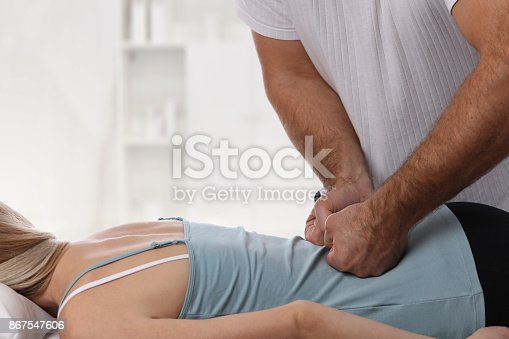 863158416istockphoto Woman having chiropractic back adjustment. Osteopathy, Physiotherapy, sport injury rehabilitation concept 867547606