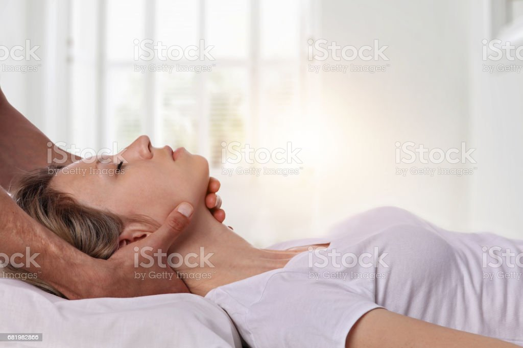 Woman having chiropractic back and neck adjustment. Osteopathy, Acupressure, Alternative medicine, pain relief concept. Physiotherapy, sport injury rehabilitation stock photo