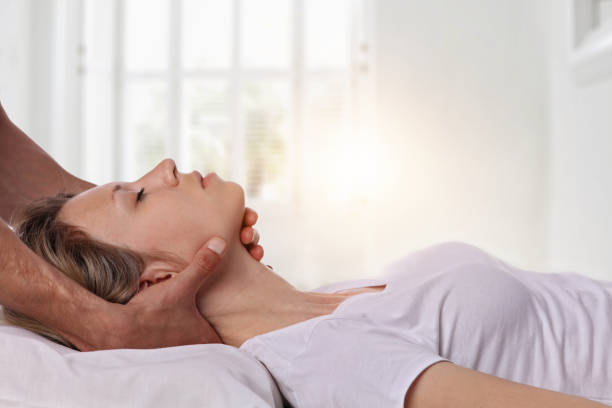 woman having chiropractic back and neck adjustment. osteopathy, acupressure, alternative medicine, pain relief concept. physiotherapy, sport injury rehabilitation - chiropractic care stock photos and pictures