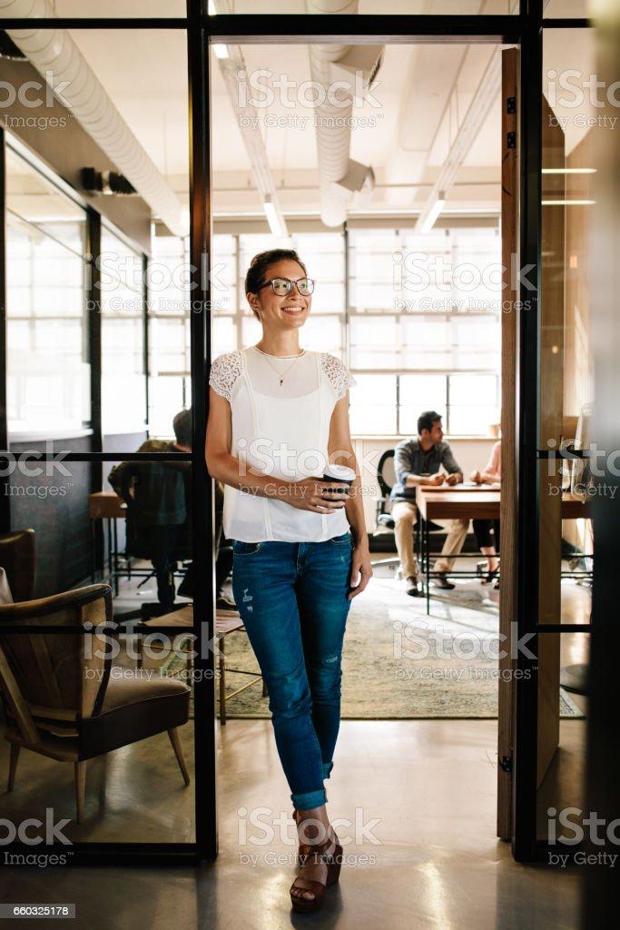 Woman having coffee break at startup stock photo