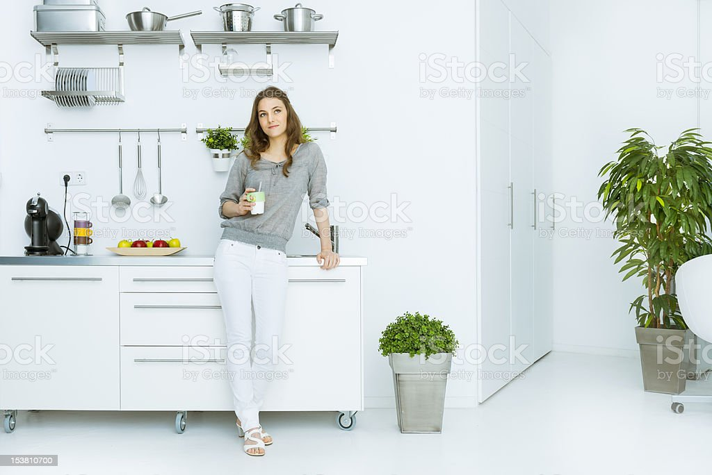 Woman having coffee in her loft stock photo
