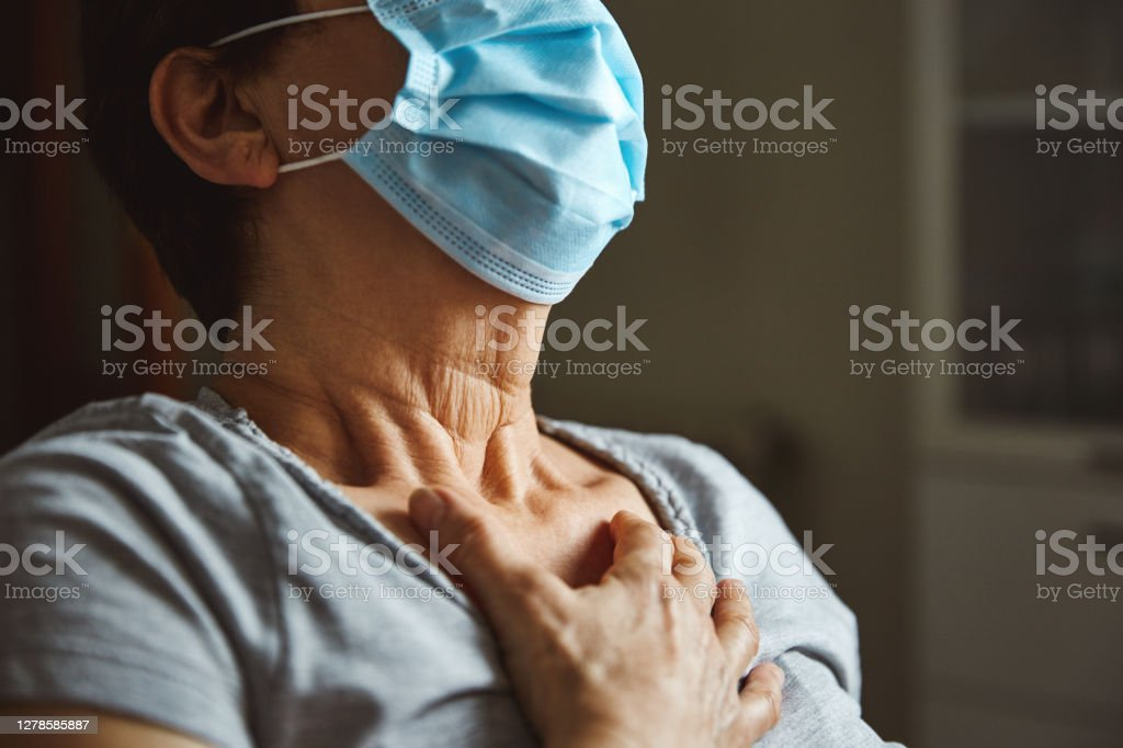 Woman having difficulty breathing Senior woman with face mask having respiratory difficulties. Seniors are the most vulnerable to coronavirus. 70-79 Years Stock Photo