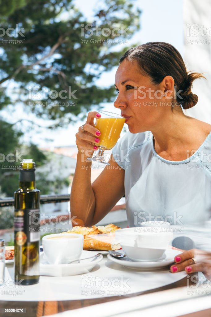 Woman having draught of juice foto de stock royalty-free