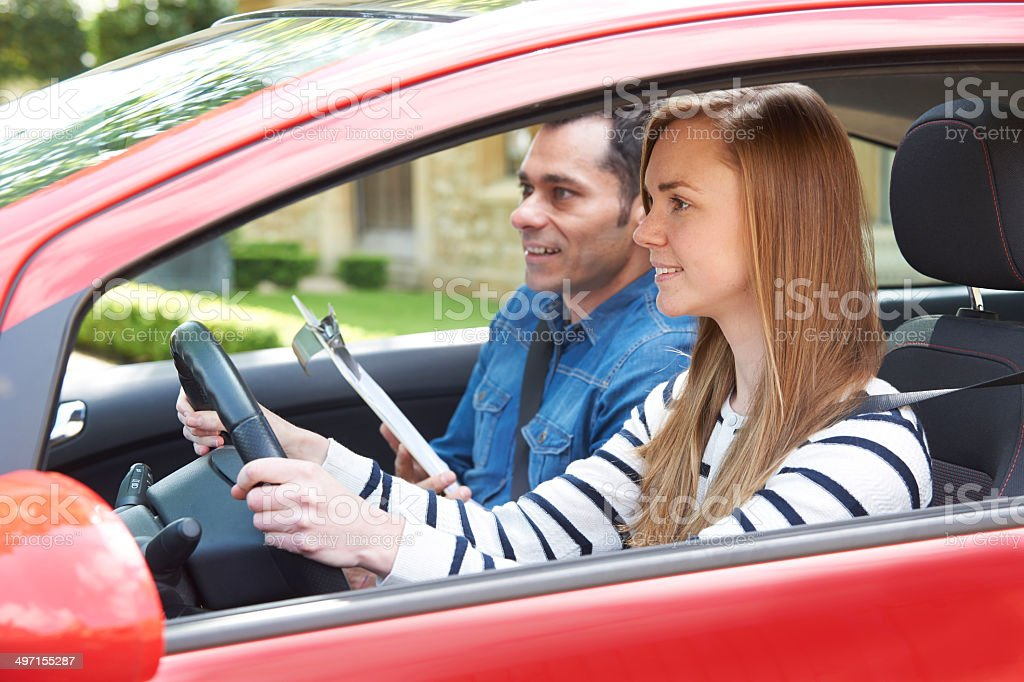 Woman Having Driving Lesson With Instructor stock photo