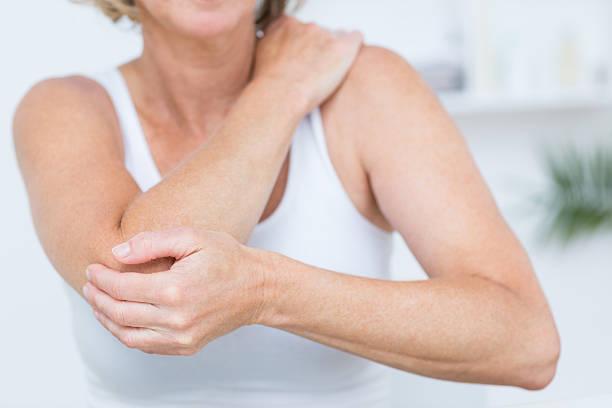 Woman having elbow pain stock photo