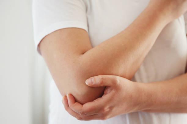 Woman having elbow pain stock photo stock photo