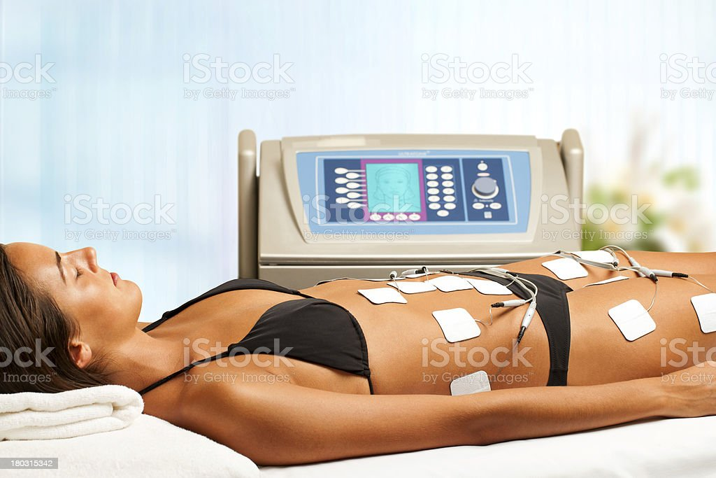 Woman having electrical lymphatic drainage. stock photo