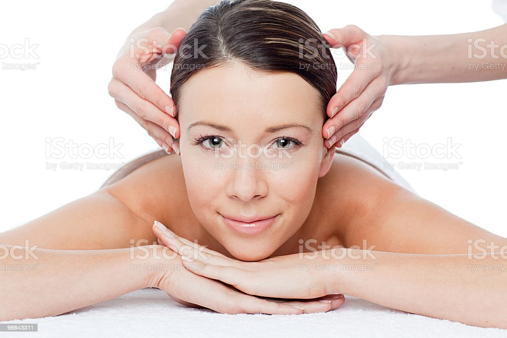 Woman having face massage royalty-free stock photo