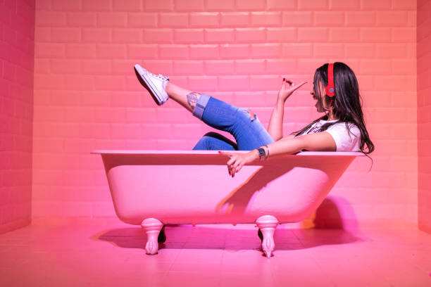 woman having fun and dancing in the pink bathtube - funky stock pictures, royalty-free photos & images