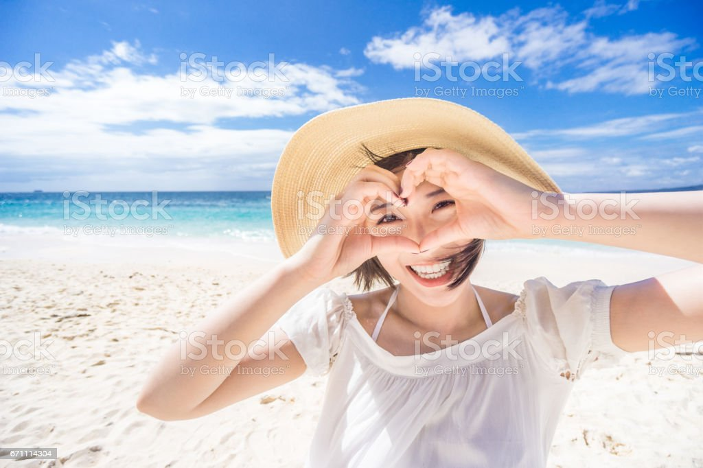Woman having fun at beach stock photo