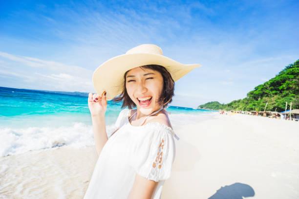 Woman having fun at beach stock photo