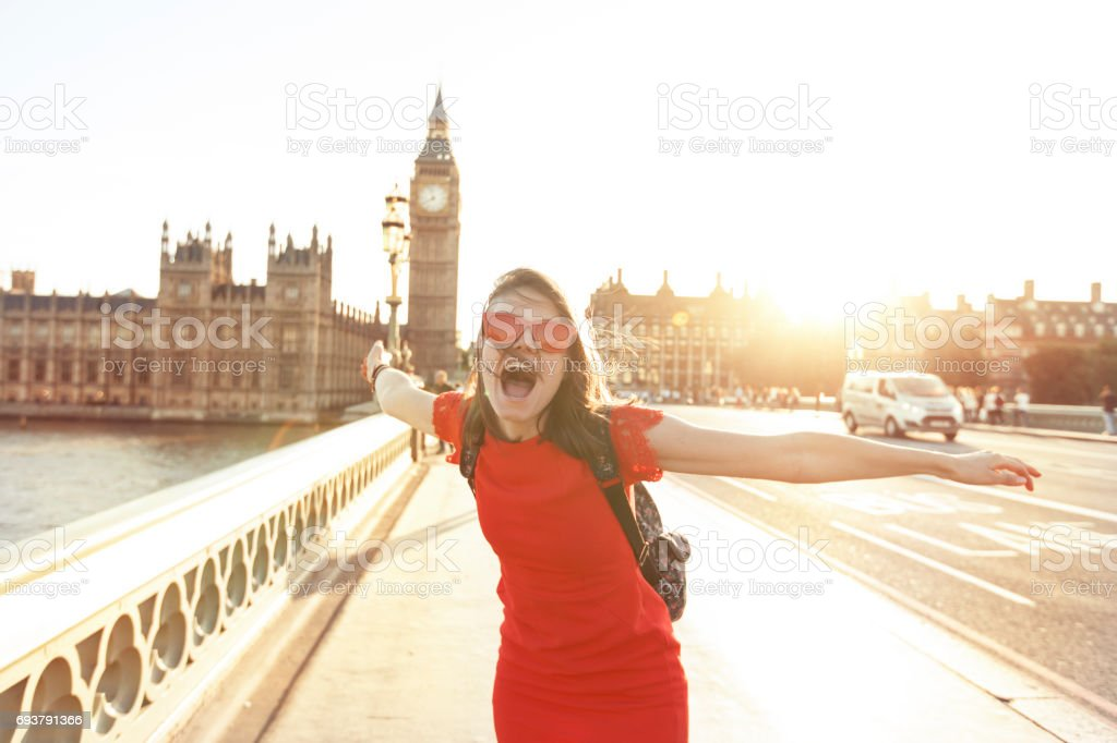 Woman having fun at sunset stock photo