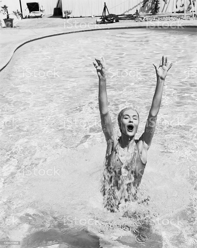 Woman having fun in swimming pool stock photo