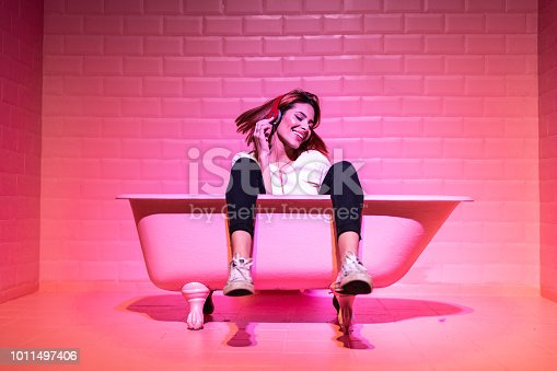 istock Woman Having Fun in the pink bathtube 1011497406