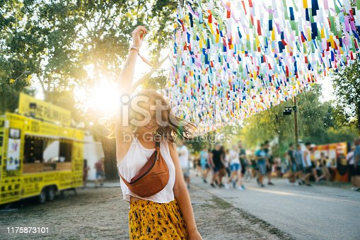 Young Caucasian woman in yellow skirt having fun on music festival in summer