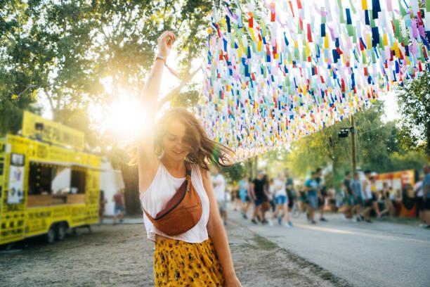 Woman having fun on music festival in summer stock photo