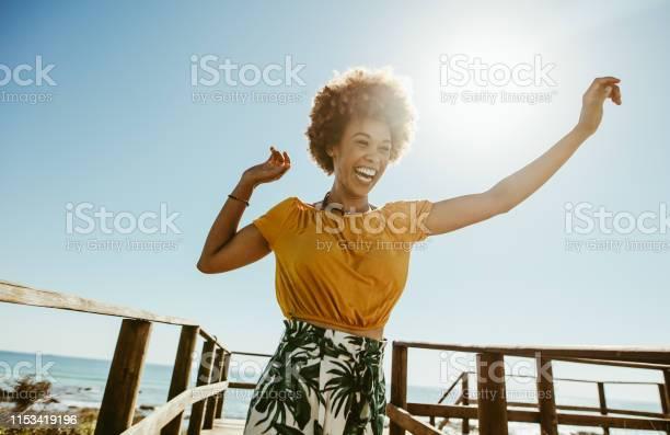 Woman having fun on summer vacation picture id1153419196?b=1&k=6&m=1153419196&s=612x612&h=2dki5 otqmvtx4h6lahsgnphe5dcnqkxhui4wwympvm=