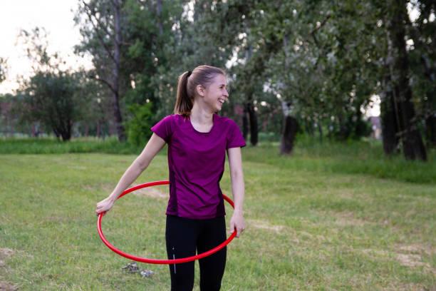 Woman having fun outdoor training stock photo