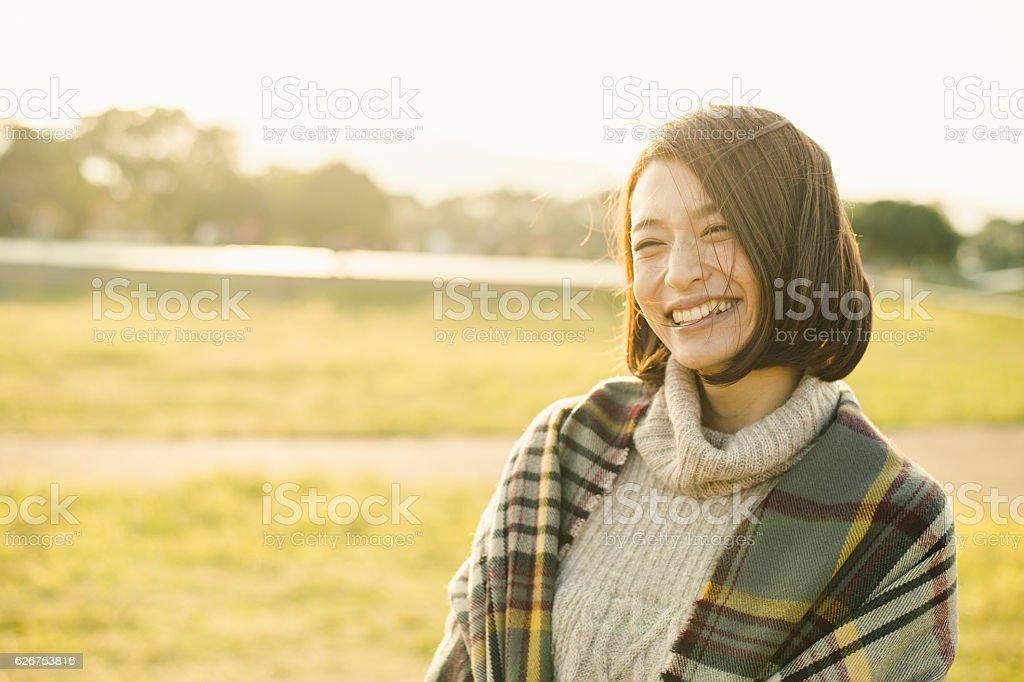 Woman having fun time in outdoors stock photo