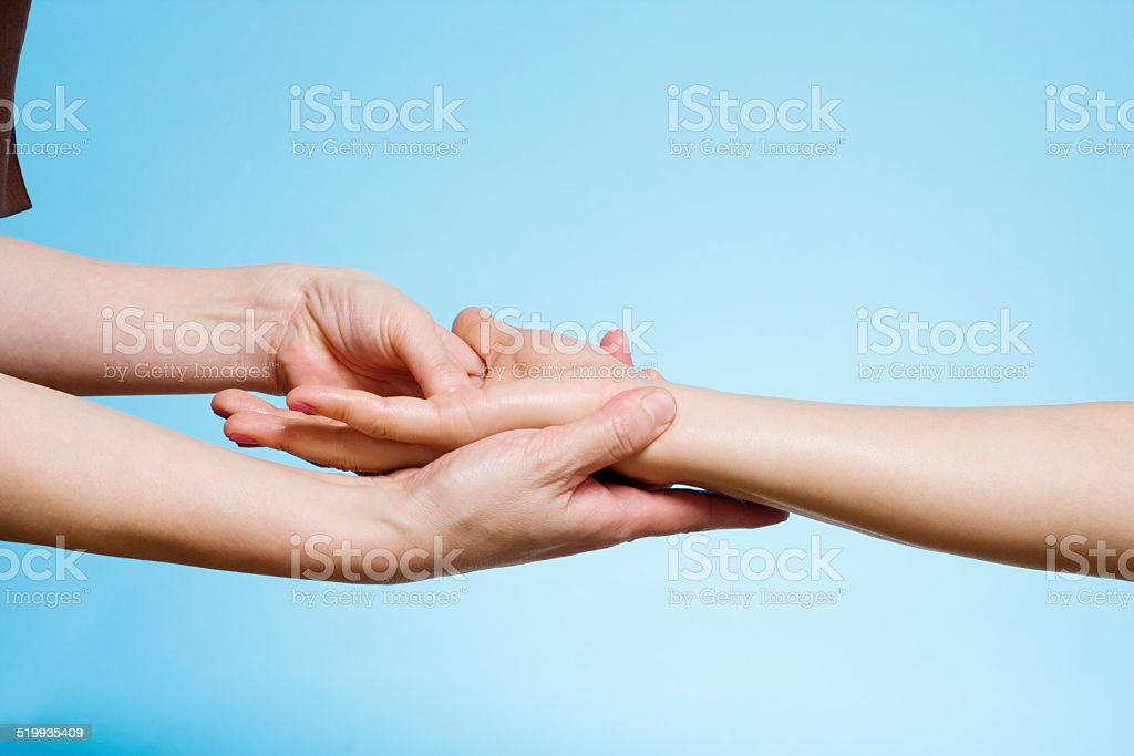 Woman having hand massage, close-up stock photo