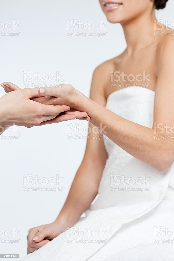 Woman having hand massage royalty-free stock photo