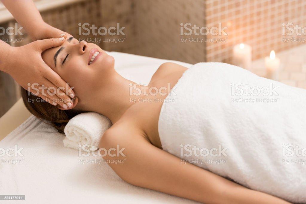 woman having head massage stock photo