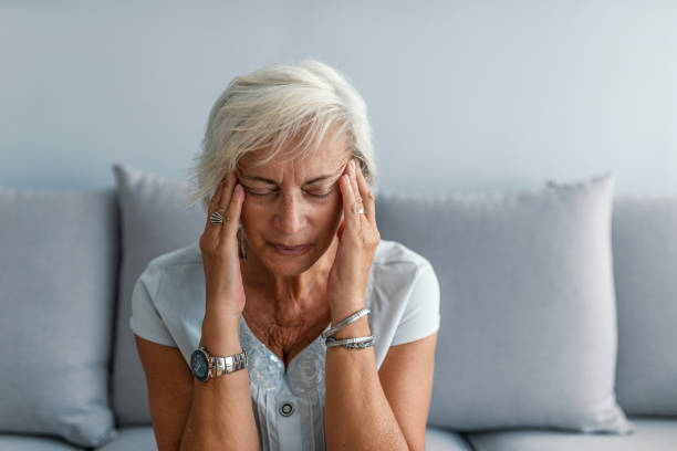 Woman having headache migraine Woman having headache migraine. Stress and depression. Health care, pain, stress, age and people concept - face of senior woman suffering from headache headache stock pictures, royalty-free photos & images