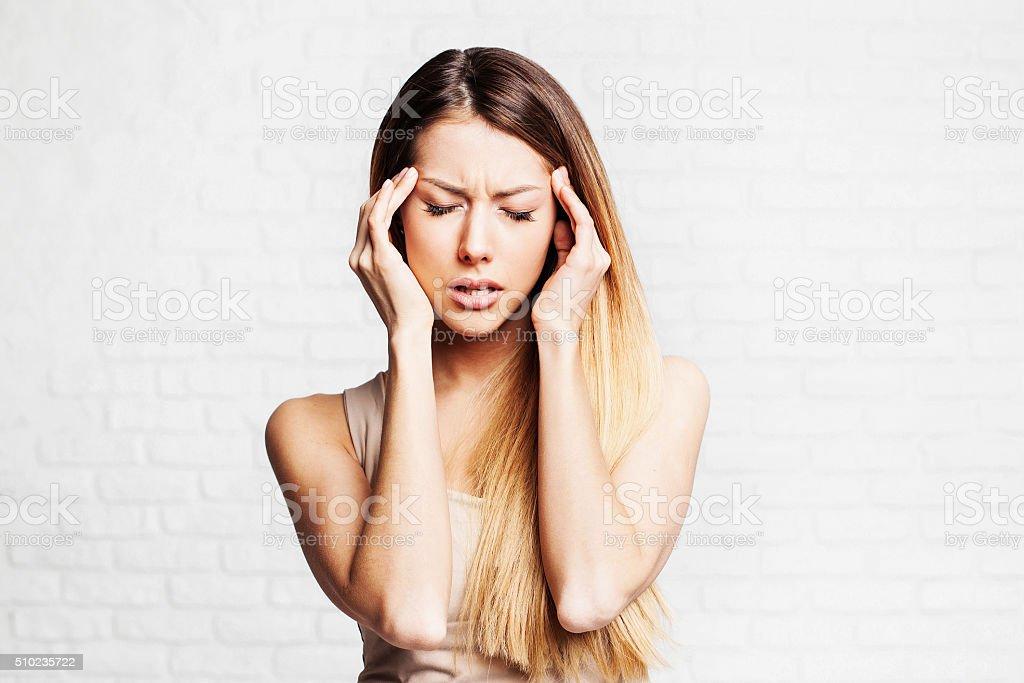 Woman having headache stock photo