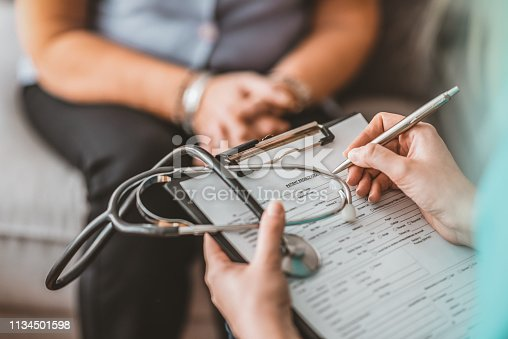 istock Woman Having Health Check With Nurse At Home 1134501598
