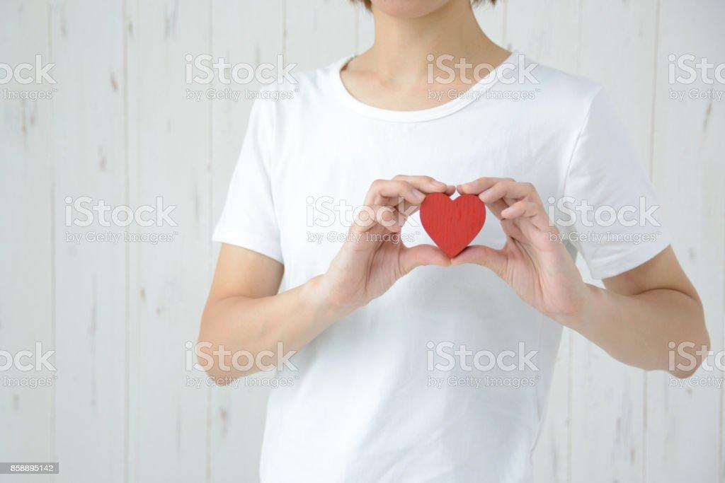 Woman having heart on bosom stock photo