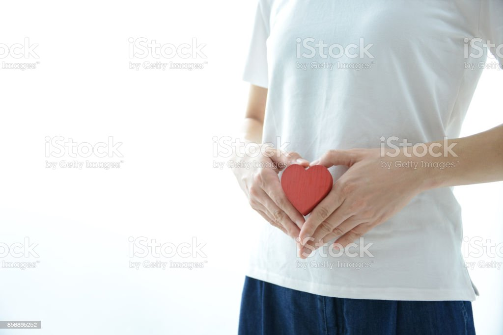 Woman having heart on stomach stock photo