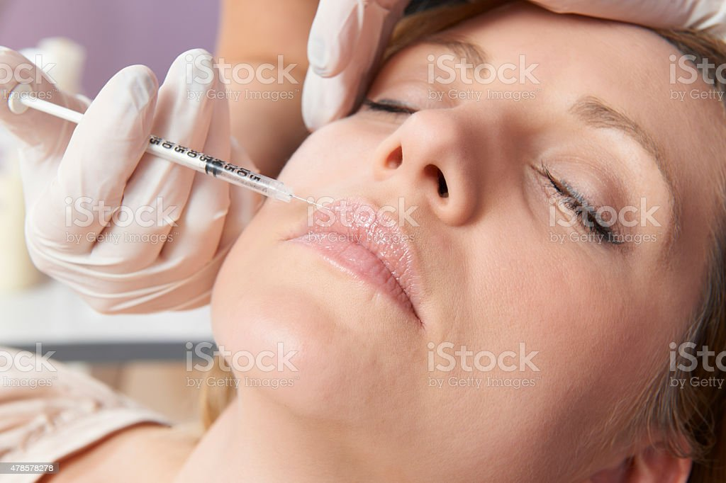 Woman Having Injection In Lips As Beauty Treatment stock photo